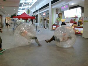 Picture of people bouncing in Zorb balls